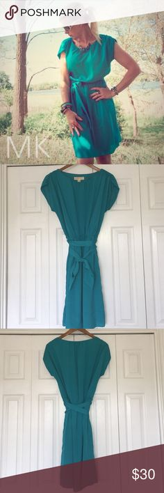 ❤️Gorgeous MICHAEL KORS Dress Size Medium ❤️ Super cute MICHAEL Michael Kors Dress in size medium. Excellent condition. Has flattering cinched waist and tie. Turquoise/Teal. Light flowy material. Dress is lined. 100% polyester. No tears or snags. Comes from a smoke free home. MICHAEL Michael Kors Dresses Midi