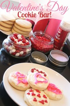 Need some new Valentines Day Recipes? I Love this idea! Create a Valentines Day Cookie Bar with Cookies, Icing in different forms and decorations. This would be fun for a Class Party with Kids! #valentinesday #recipes