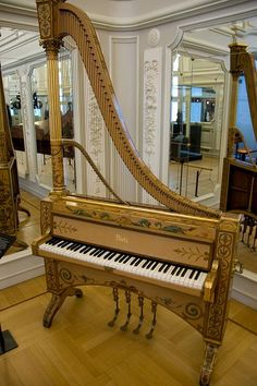 Brussels- Musical Instruments Museum  Appears to be a combination harp/piano, or a way of opening it up to get the string tones out more?