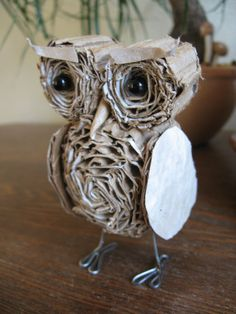 Awesome cardboard owl! -- Another way to use mundane material, cardboard as a lively sculptural material.
