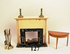 """Tynietoy fireplace and half moon table, table marked with Tynietoy logo. Fireplace is not marked, includes fireplace tools, andirons and candlesticks shown, 11 pieces, 5 1/4""""t"""