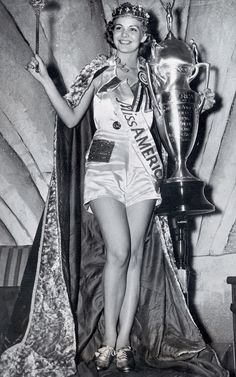 A 1938 winner basks happily in her glory in what appears to be a shiny romper. I dig. | The First Miss America Pageants Are Shockingly Different From Today's