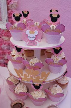 Sparkly cupcakes at a pink and gold Minnie Mouse baptism party! See more party planning ideas at CatchMyParty.com!