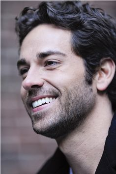 Zachary Levi...sad, but true, story: Yesterday, I was watching the movie Video Game High School with my kids...and the teacher of the first-person shooter class was Zachary Levi...I squealed. Literally, squealed, like a little girl. Him, plus my favorite type of video game....*swoon*