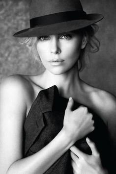 Charlize Theron - I think the bare shoulders make the hat look real good.
