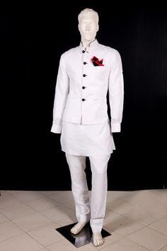 White Pure Linen short Kurta and Jodhpuri trousers. White Nehru jacket with Black Trimmings.