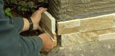 Dressing up a block wall with stone-veneer panels, with This Old House landscape contractor Roger Cook