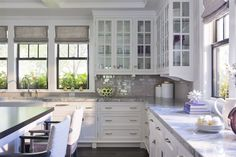Martha O'Hara Interiors - kitchens - inset cabinets, flush front cabinets, nickel cabinet hardware, gray stone counters, gray kitchen counters, glossy gray subway tile, gray subway tile
