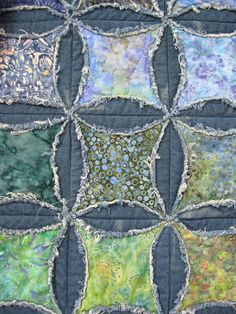faux cathedral windows quilt, denim circles with batik inside