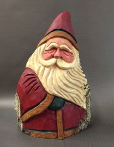 A personal favorite from my Etsy shop https://www.etsy.com/listing/400494879/hand-carved-original-fat-santa-with