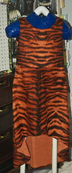 My daughter wanted to be a tiger for Halloween so I made her this cute little dress.  Not only does it have a tail, but it can be worn any time of the year.