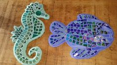 Sea horse and fish mosaic. Used millefiori, fused glass tiles, iridescent tiles,  stained glass and vitreous tiles.  Seagrass and ultramarine pigment mixed in white grout.