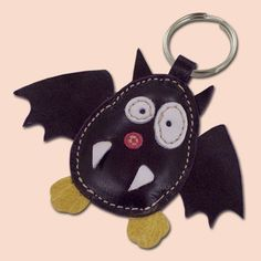 This cute little bat keychain is completely made of 100% natural leather. Bat is filled with cotton wool to get 3D look and soft touch. Dimensions of the bat are 9 x 7,5 cm (3,54 x 2,95 in).     Accessories Keychain Women charm men zipper pull bat vampire purple stuffed animal gift leather