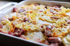 Ree Drummond / The Pioneer Woman, Ham and Scalloped Potatoes; sauce is simply warmed half&half + cream mixed with flour! baked for 60 min - will do in crockpot!