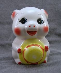 Hey, I found this really awesome Etsy listing at https://www.etsy.com/listing/94008482/vintage-cute-pottery-piggy-bank-hat-in