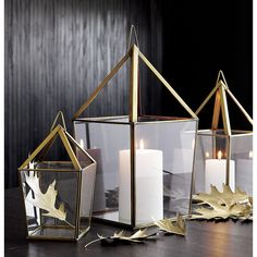Shop Lillian Brass Metal Extra Large Lantern.  Open pyramid shines bright in antiqued brass and transparent glass with a mirrored base to reflect even more light.  Hangs by metal loop or sits flat.