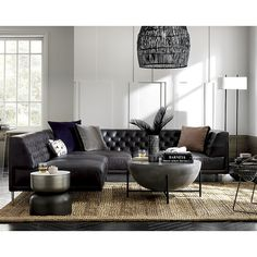 Shop Savile Black Leather Tufted Sectional Sofa. We edged up the classic Chesterfield silhouette with buttery black leather and clean modern lines. Out with the traditional curved arms and in with a minimal squared-off frame.