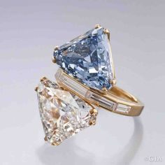 "The ""Bvlgari Blue"" ring features a carat Fancy Vivid blue diamond set with a carat G-Color diamond Most Expensive Diamond Ring, Most Expensive Jewelry, Expensive Engagement Rings, Expensive Rings, Silver Diamonds, Diamond Studs, Natural Diamonds, Colored Diamonds, Diamond Jewelry"