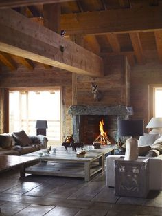 Rustic modern living room with pelts and a symmetrical lodge layout