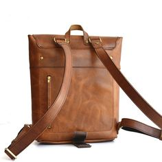 New for 2016! The Solid Leather Co. Rucksack is here. Its rugged, yet refined. This simple take on a minimalist backpack is sure to be a favorite. Designed with simplicity in mind, you will find that the Rucksack is a great stuff hauler. With one large compartment secured with a flap and two straps, it will easily accommodate your 15 laptop, books, and more. Theres also a zippered pocket that gives you quick access from the outside. This pocket is great for a wallet, car keys, and/or your…