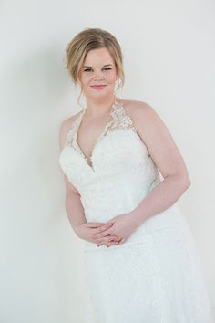09bcee1fa122 Fitted, plus size wedding dress with halter neckline. Sparkly lace, fitted  silhouette with a tulle overlay.
