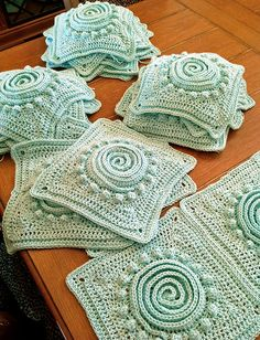 "My latest Crochet Obsession: Squares ready to go! I've never made anything with squares and I made up this pattern for what I think is going to be a bedspread. 12"" squares made with Caron Simply Soft – ""Soft Green"". Now I'm just experimenting with different ways to join them. Aaarrrgggh!"