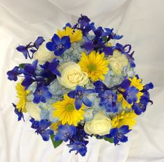 Blue, yellow and white bridal bouquet with delphinium, hydrangea, daisies and roses by Nancy at Belton hyvee.