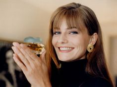 Mega-model Paulina Porizkova gets playful with a bottle of knowing perfume. She was in town recently