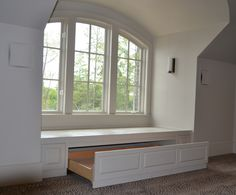 fieplace with window seats   Northshore Millwork, LLC   Photo Gallery