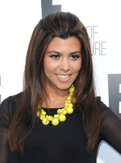 Kourtney Kardashians sleek and straight hairstyle
