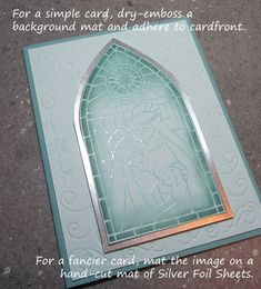 Stamin' Up! ... handmade Christmas card ... white with soft teal and silver ... silver embossed stained glass window on vellum ... tinted from back side ... shiny silver mat ... wonderful!