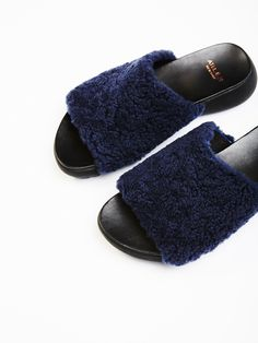 Rockwood Fur Slide Sandal | Perfect for the season, these slide style sandals feature an ultra cool platform and a cute faux shearling detail across the top of the foot.