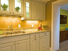 Shane Inman designed this transitional kitchen with marble countertops and under-cabinet lighting.