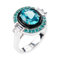 Yesterday collection pays tribute to the elegance and symmetry of Art Deco jewellery, fuelled with neon-bright apatite. This fabulous white gold ring by Nikos Koulis features a round-cut apatite at its heart, encircled by black enamel. A halo of Paraiba tourmalines and baguette-cut diamond side stones complete the colourful picture.