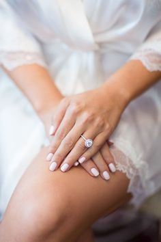 Bride's Halo Engagement Ring & Pale Pink Manicure | Photo: Duke Photography. View More: http://www.insideweddings.com/weddings/jewish-ceremony-classic-ballroom-reception-in-beverly-hills/922/