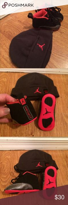 Baby Jordan Shoes and Hat Brand new and still in the box baby Jordan crib shoes and hat.  Size 2 child in black and red. Jordan Shoes Baby & Walker