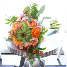 Coral bridal bouquet  succulents, roses, ranunculus, asclepia  orange, coral, pink, green  #campusfloral