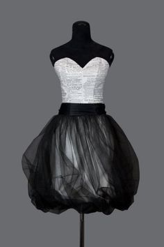Top of the dress looks like book pages with a black skirt