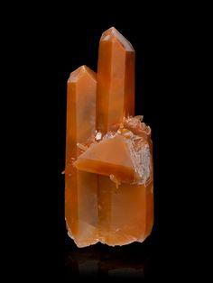 New Tangerine Quartz just added. See more here: http://www.exquisitecrystals.com/quartz/tangerine-quartz