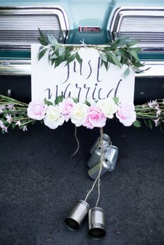 Classic tin cans: http://www.stylemepretty.com/2015/09/11/smps-favorite-ways-to-say-just-married/