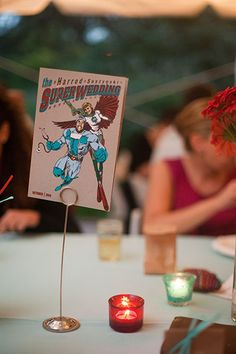 This bride and groom had comic versions of themselves designed for their wedding-day stationery.Photo Credit: Cat Norman Photography