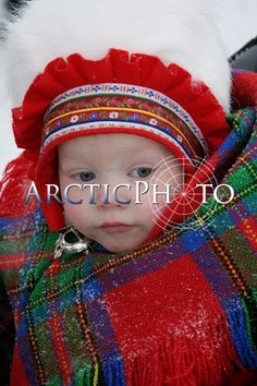 Sami baby girl in traditional hat and shawl.Jokkmokk winter Market. Sweden. Size to A4: Sami, Jokkmokk Market: Arctic & Antarctic photographs, pictures & images from Bryan & Cherry Alexander Photography.