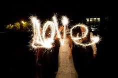 @Julie Ruhaak your wedding is close enough! ..what another pinner said: Sparklers at your wedding are a MUST...beautiful especially for a wedding on 4th of July. We could do a Sparkler tunnel for you guys to run out of at the end of the reception and then also take fun wedding pics like this with them.