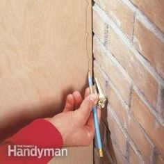 How to Scribe for a Perfect Fit Fit woodwork perfectly to even the waviest walls with an inexpensive compass. Read more: http://www.familyhandyman.com/tools/how-to-scribe-for-a-perfect-fit/view-all