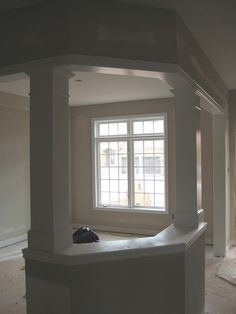 open up kitchen to living room... - Could use columns like this for load if need be on kitchen project