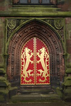 https://flic.kr/p/5r73tb | Cheadle's west doors | The splendid west doors of St Gile's church in Cheadle has two gilded rampant lions, a device from the arms of John Talbot, 16th Earl of Shrewsbury who financed this glorious church in 1841-46.