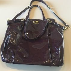 Used Coach plum purse large  Great purse. Used for one season. Staining on inside and slight use on outside. Has long strap but not crossbody. The spring on one end of the long strap needs to be replaced since it won't stay closed. Not for trade  Coach Bags Shoulder Bags