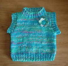 This sweet little top can be made with chunky yarn or with double DK. I used one ball of turquoise acrylic yarn and one bal...