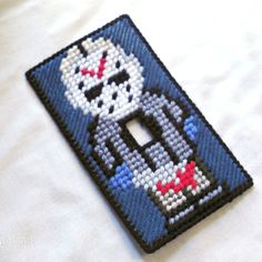 Up for sale is a plastic canvas light switch/switch plate cover featuring Friday the 13th's Jason Voorhees. This light switch cover fits a standard single switch plate. This switch plate cover is 100% handmade by me with all new materials. You will be getting the actual item pictured, it...