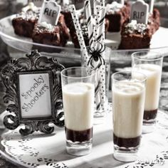 To make, fill each glass with 1 part chocolate liqueur and top off with 4 parts frothed coconut milk. Serve on an antique-look tray lined with a white doily to give the party a chilling haunted-mansion feel.